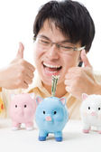 Asian businessman saving money — Stock Photo