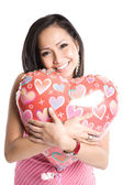 Asian woman with heart-shaped balloon — Stock Photo