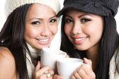 Asijské ženy pití kávy — Stock fotografie