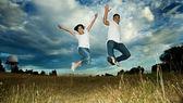 Asian couple jumping in joy — Stock Photo