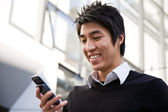 Casual asian businessman texting — Stock Photo