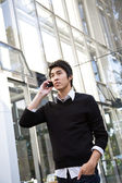 Casual asian businessman on the phone — Stock Photo