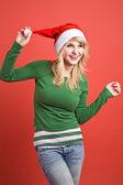Caucasian girl wearing santa hat — Stock Photo
