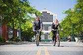 Business riding bicycle — Stock Photo