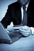 Senior businessman shopping online — Stock Photo