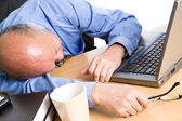 Sleeping senior asian businessman — Stock Photo