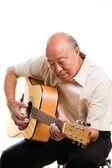 Senior asian playing guitar — Stock Photo