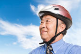 Active senior asian businessman — Stock Photo