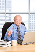 Working senior asian businessman — Stock Photo
