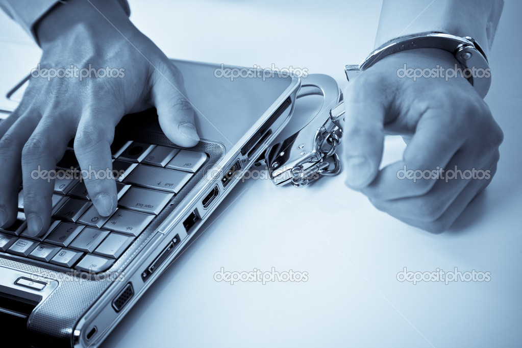A shot of a businessman handcuffed on laptop — Stock Photo #5453619