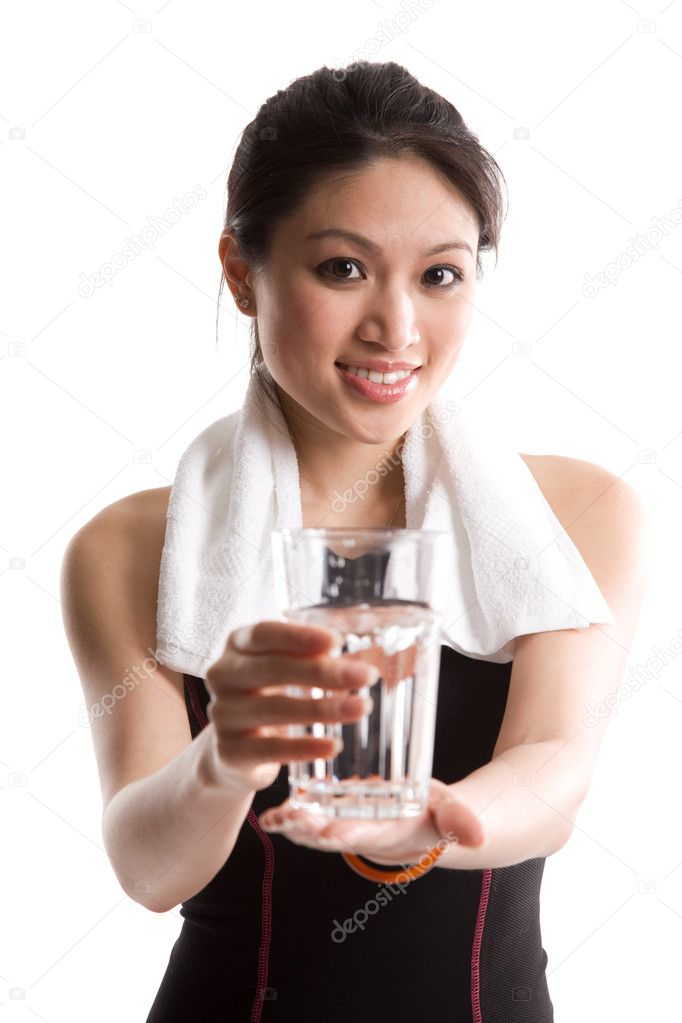 An isolated shot of a healthy asian girl holding a glass of water  Stock Photo #5453919