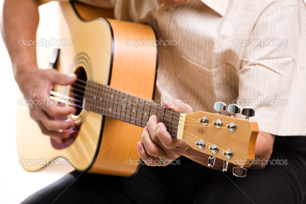 A shot of a senior man playing guitar — Stock Photo #5454856