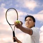 Asian tennis player — Stock Photo #5567085