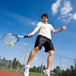 Asian tennis player — Stock Photo #5567093