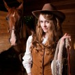 Beautiful caucasian cowgirl with a horse — Stock Photo #5567244