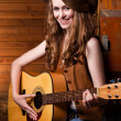 Beautiful caucasian cowgirl with guitar — Stock Photo