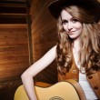 Beautiful caucasian cowgirl with guitar — Stock Photo #5567272