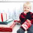 Boy with christmas gift — Stock Photo