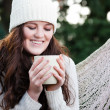 Beautiful teenager drinking coffee - Stock Photo