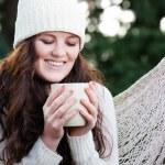 Beautiful teenager drinking coffee — Stock Photo #5567532