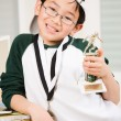 Winning boy with his medal and trophy — Stock Photo #5567747