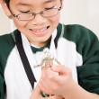 Winning boy with his medal and trophy — Stock Photo