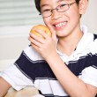 Studying kid eating apple — Stock Photo