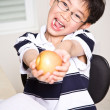 Studying kid holding an apple — Stock Photo