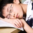 Sleeping young student — Stockfoto