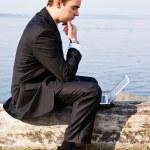 Caucasian businessman with laptop — Stock Photo