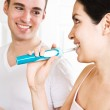 Couple brushing teeth in the bathroom — Stock Photo #5567908