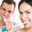 Couple brushing teeth in the bathroom - Stock Photo