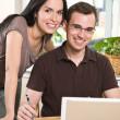 Couple paying bills by online banking — Stock Photo #5567931