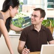 Couple paying bills by online banking - Stock Photo