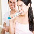 Couple brushing teeth in the bathroom — Stock Photo #5567943