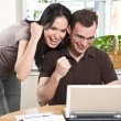 Stock Photo: Happy couple online banking