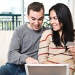 Happy couple shopping online from home - Stock Photo