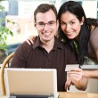 Happy couple shopping online - Stock Photo