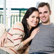 Happy couple relaxing at home — Stock Photo #5567976