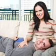 Happy couple relaxing at home — Stock Photo #5567977