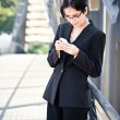 Royalty-Free Stock Photo: Hispanic businesswoman texting