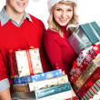 Christmas shopping couple carrying gifts — Stock Photo #5568041