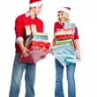Christmas shopping couple carrying gifts — Stock Photo