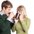 Caucasian couple holding coffee cups — Stock Photo #5568145