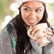 Beautiful asian woman drinking coffee - Stock Photo