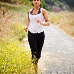 Sporty running woman — Stock Photo