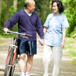 Senior active asian couple - Stock Photo