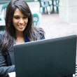 Indian businesswoman with laptop — Stock Photo