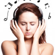 Beautiful woman listening music - Stock Photo