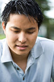 Sad and depressed asian man — Stock Photo